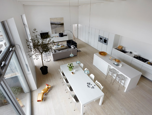 Two neighbouring loft apartments in London converted into one huge flat
