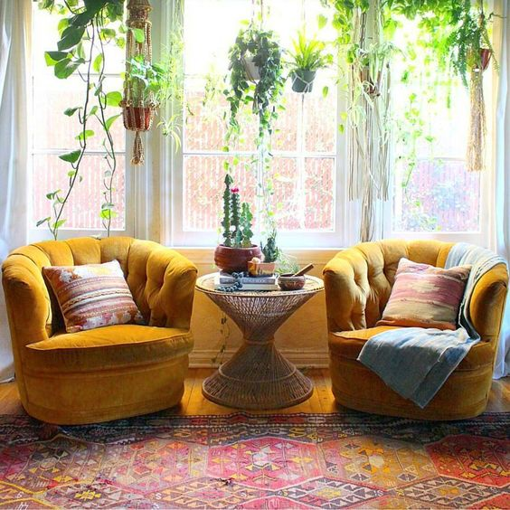aztec-pillowcase-blanket-bohemian-interior-modern-living-room-hanging-plants-mustard-love-chair-bamboo-table