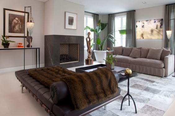 brown-faux-fur-brown-leather-day-bed-pink-sofa-fireplace-indoor-plants-modern-living-room