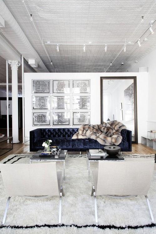 brown-faux-fur-throw-blue-sofa-floor-length-mirror-industrial-lighting-interior-modern-living-room