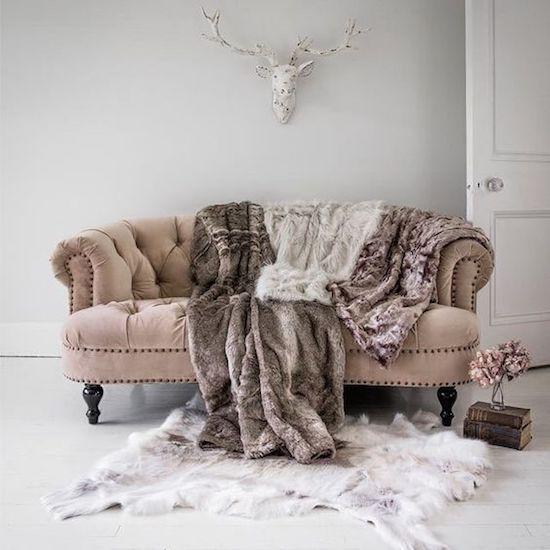 brown-fur-throw-on-beige-sofa-brown-blanket-modern-living-room