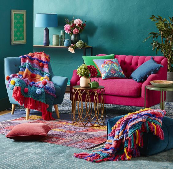 colourful-blanket-bohemian-blanket-bohemian-interior-modern-living-room-turqoise-walls-pink-sofa-flowers