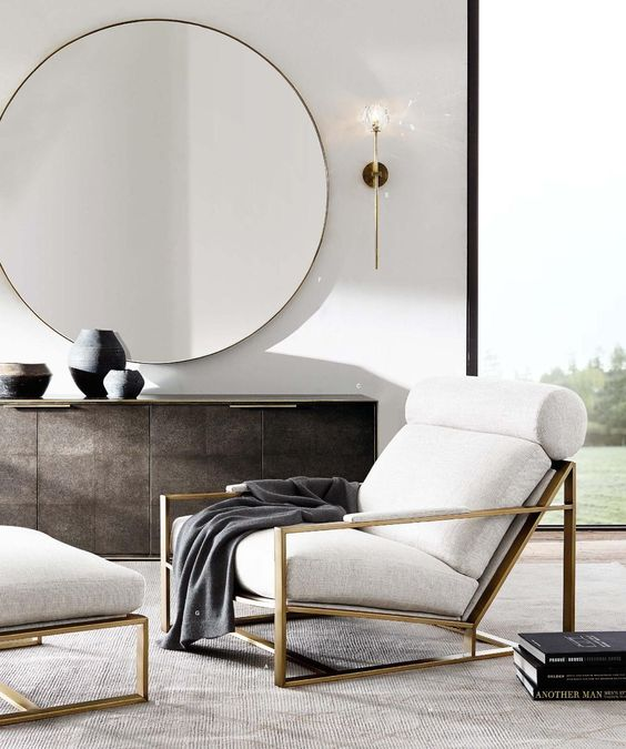 grey-blanket-white-armchair-gold-trimmings-gold-mirror-modern-living-room