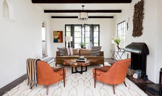 orange-blanket-orange-armchair-fireplace-modern-living-room