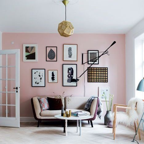 white-faux-fur-throw-grey-blanket-pink-walls-parquet-flooring