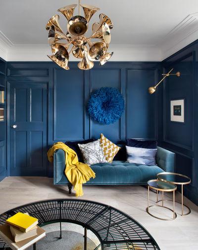 yellow-blanket-teal-sofa-cushions-blue-walls-modern-living-room